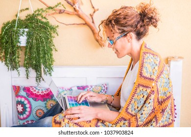 full of color image for middle age woman working freedom at laptop outdoor in the terrace, plants and nature in the background for independence concept