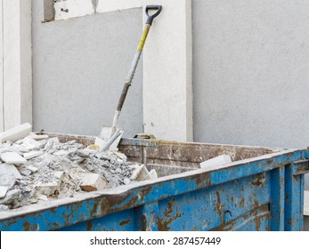 Full construction waste debris container, garbage bricks and material from demolished house