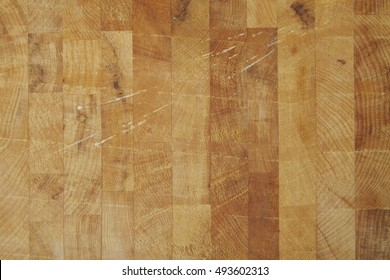 A full crop of olive wood butchers block background texture