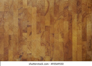 A full crop of olive wooden butchers block background texture