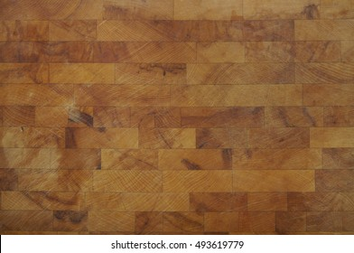 A full crop of olive wooden chopping board background texture
