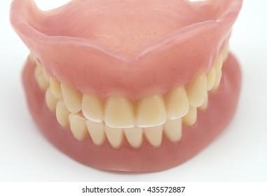 full denture on white background, medical denture smile jaws teeth on white background
