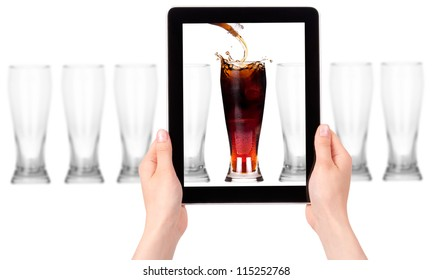 full and empty glass of fresh cola drink isolated on a digital tablet screen.leader concept