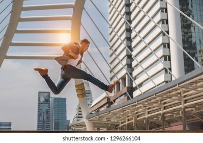 Full of energy. Full length of handsome young man jmping in in a city street on a background rush hour,copy space.