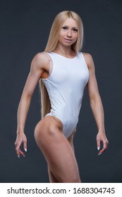 Full face portrait of fitness sexy woman in white gym leotard isolated on black background