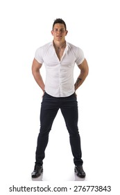 Full figure of handsome young man standing confident in casual clothes, looking at camera isolated on white