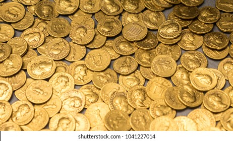 Full frame abstract background texture of an old Roman gold coin hoard.