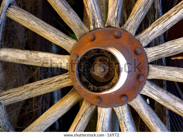 A full frame aged and rusty wagon wheel.