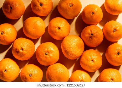 Full frame of arranged fresh wholesome tangerines on beige background