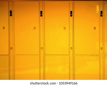 Full Frame Background of Glossy Vivid Yellow Lockers