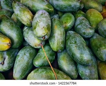 Full Frame Background of Pile of Fresh Green Ripe Mangoes at Market