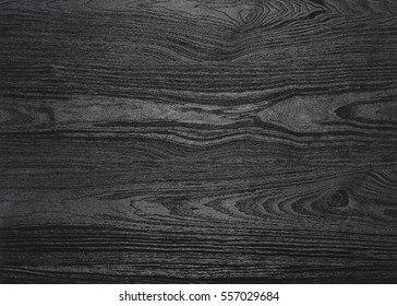 a full frame black wood grain surface