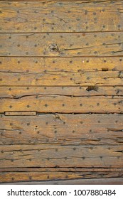Full frame close up texture of the planks of an old wooden door