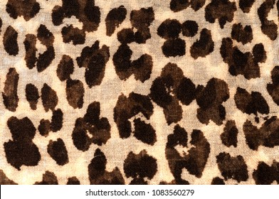 Full frame closeup of some cheetah print.