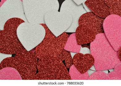 A full frame of colorful glitter hearts