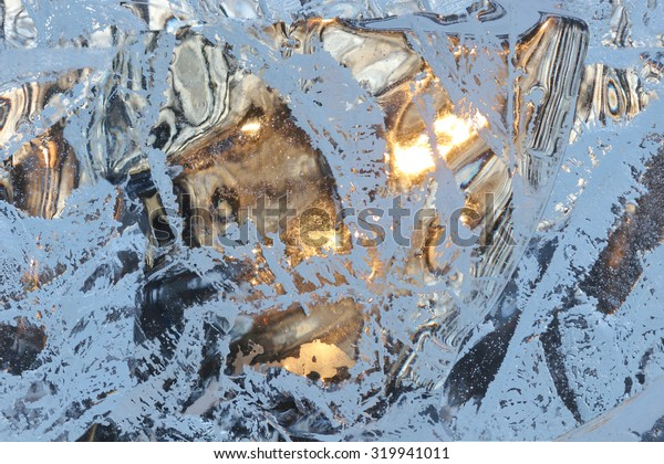 Full frame ice background. Backlit with the sun
