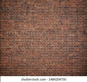 Full frame image of the old red brick wall. High resolution texture with vignetted corners for background, poster, collage in the vintage, loft or grunge style
