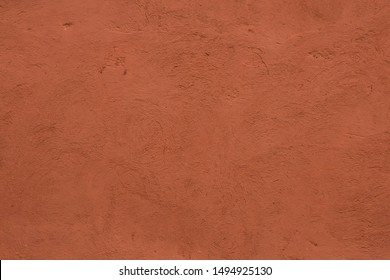 Full frame image of textured stucco in bright terracotta color. High resolution abstract texture for 3d model, background, pattern, poster or collage