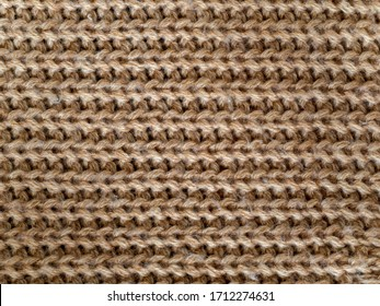 Full frame light brown color wool knitting pattern - Shutterstock ID 1712274631
