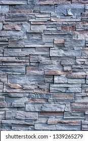 full frame photo of a grey stone wall