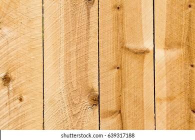 Full frame planks of a new cedar privacy fence