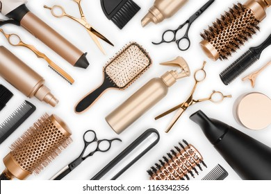 Full frame of professional hair dresser tools on white background