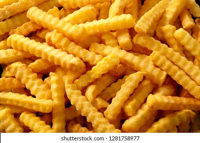 Full frame rippled french fries or chips in overhead view for advertising concept.