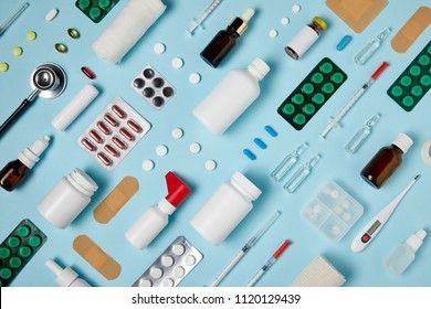 full frame shot of composed various medical supplies on blue surface