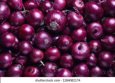 Full Frame Shot Of Purple Onions. Fresh purple onions as a background.