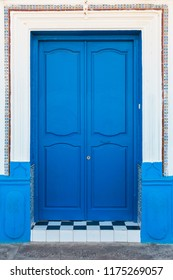 full frame shot of a traditional moroccan door painted in blue - Asilah, Morocco