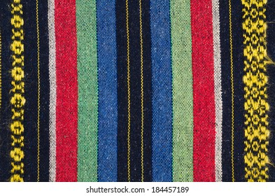 Full frame take of a old colorful striped fabric