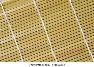 Full frame take of an olive green bamboo mat