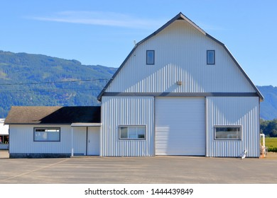 Full frontal view of a traditional North American wood frame Prairie or Western barn.