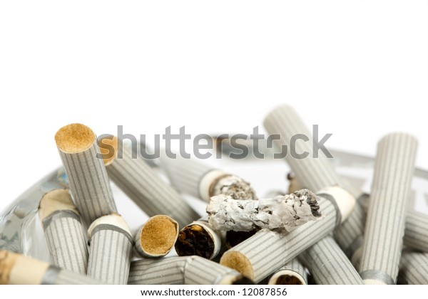 full glass ash-tray with cigarettes isolated on white