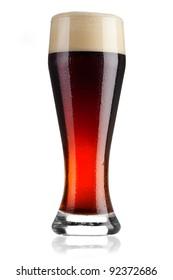 Full glass of cold dark beer on white background