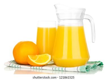 Full glass and jug of orange juice and oranges isolated on white