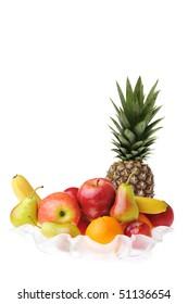 full glass vase of ripe tasty fruit