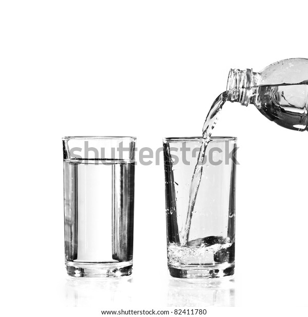 a full glass of water and an empty glass to be filled