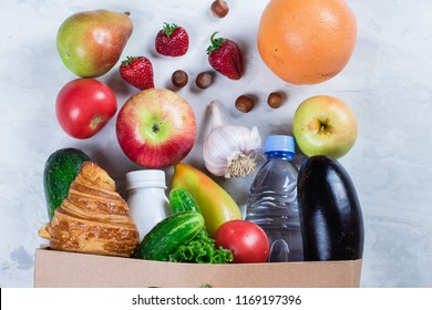 Full Grocery Paper Bag of healthy food fruits and vegetables on a white table background. Top view. Flat lay. Copy Space