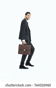 in full growth. a businessman with a leather briefcase walks up.