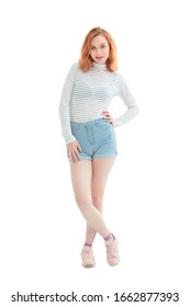 in full growth. confident model girl in jeans shorts