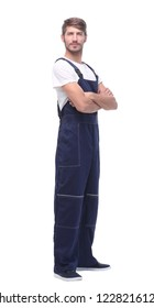 in full growth. smiling man in blue overalls