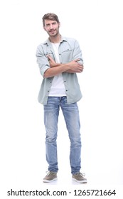 in full growth. smiling young man in jeans
