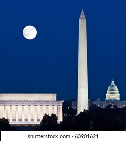 Full Harvest moon rising above the Lincoln Memorial with Washington Monument and Capitol building aligned