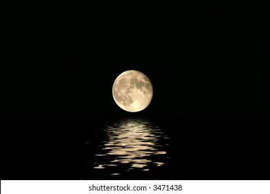 Full harvest moon seen over an expanse of water