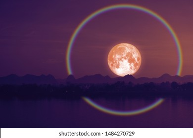 Full hay moon halo back silhouette mountain and river, Elements of this image furnished by NASA
