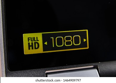 Full HD 1080 1080p sticker logo placed on the screen of a foldable 2-in-1 laptop