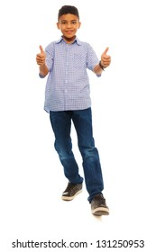 Full height portrait of black school boy with thumbs up, standing isolated on white