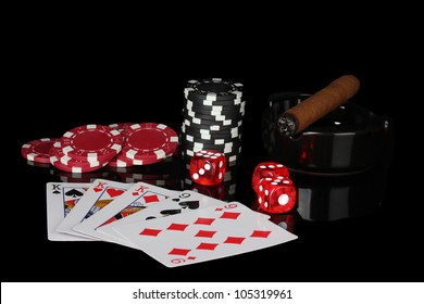 full house of poker chips and dice on black background