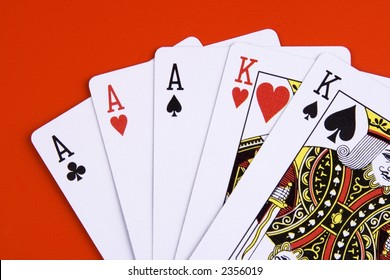 A full house poker game on red background.